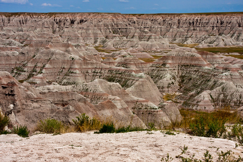 Badlands National Park in South Dakota. Authorized as Badlands National Monument on March 4, 1929, President Franklin Roosevelt issued a proclamation on January 25, 1939 that established Badlands National Monument. In the late 60's, Congress passed legislation adding more than 130,000 acres of Oglala Sioux tribal land, used since World War II as a U.S. Air Force bombing and gunnery range, to the Badlands to be managed by the National Pakr Service. An agreement between the Oglala Sioux Tribe and the National Park Service governing the management of these lands was signed in 1976. The new Stronghold and Palmer Creek units added lands having significant scenic, scientific and cultural resources. Congress again focused it's attention on the Badlands in 1978 on 10 November, it was redesignated as Badlands National Park. Badlands National Park contains the world's richest Oligocene epoch fossil beds, dating 23 to 35 million years old. The evolution of mammal species such as the horse, sheep, rhinoceros and pig can be studied in the Badlands formations.  This park also contains and shares National Grasslands areas.