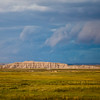 Storm Clouds developing over Badlands National Park in South Dakota. Authorized as Badlands National Monument on March 4, 1929, President Franklin Roosevelt issued a proclamation on January 25, 1939 that established Badlands National Monument. In the late 60's, Congress passed legislation adding more than 130,000 acres of Oglala Sioux tribal land, used since World War II as a U.S. Air Force bombing and gunnery range, to the Badlands to be managed by the National Pakr Service. An agreement between the Oglala Sioux Tribe and the National Park Service governing the management of these lands was signed in 1976. The new Stronghold and Palmer Creek units added lands having significant scenic, scientific and cultural resources. Congress again focused it's attention on the Badlands in 1978 on 10 November, it was redesignated as Badlands National Park. Badlands National Park contains the world's richest Oligocene epoch fossil beds, dating 23 to 35 million years old. The evolution of mammal species such as the horse, sheep, rhinoceros and pig can be studied in the Badlands formations.  This park also contains and shares National Grasslands areas.
