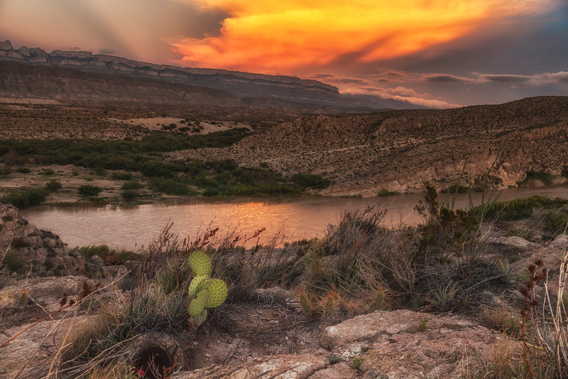 Sunset reflecting in the Rio Grande River in Boquillas Canyon with a backdrop of the Sierra del Carmen Mountains of Mexico.