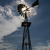 Silhouette of Windmill with starburst at Dugout Wells in Big Bend National Park.