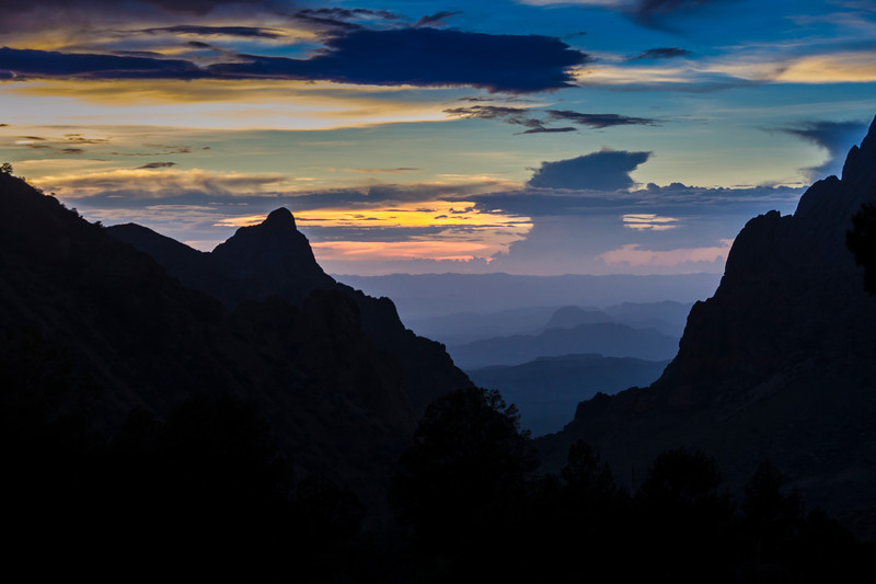 The Window, an iconic view in the Chisos Mountains, silhouetted at sunset in Big Bend National Park.