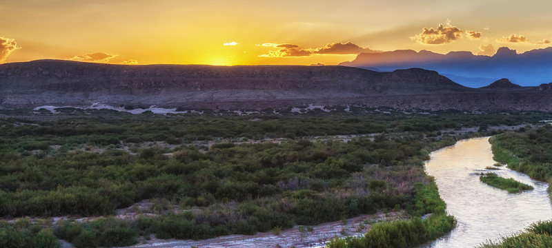 Sunset over Chisos Mountains with Rio Grande River in Big Bend National Park.