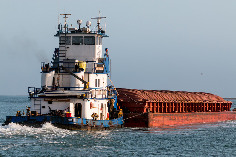 Tugboat and Barge in Aransas Bay, near Port Aransas, Texas.