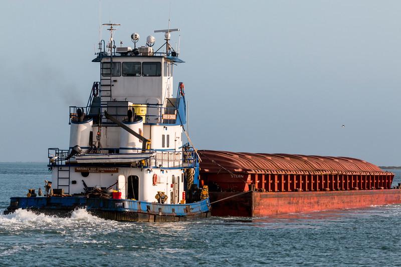 Tugboat and Barge in Aransas Bay, near Port Aransas, Texas.