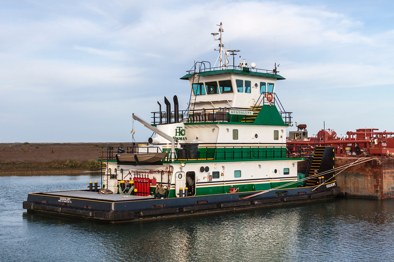 Tugboat and Barge in Aransas Bay near Port Aransas, Texas.