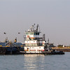 Tugboat and barge at Port Aransas Harbor, Port Aransas, Texas.
