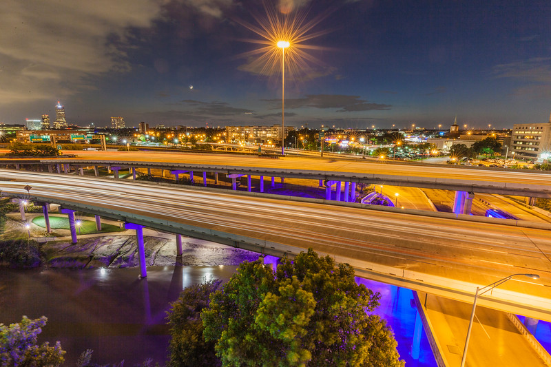 light from cars streaking on Interstate 45 through Houston at night