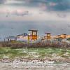 Empty lifeguard stations on Galveston East Beach.