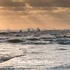 Dramatic wind and waves at sunrise on Galveston East Beach.