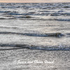 Waves and reflections in early morning light on Galveston East Beach.