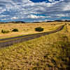 Road through rolling grasslands in the valleys of the Davis Mountains in Southwest Texas.