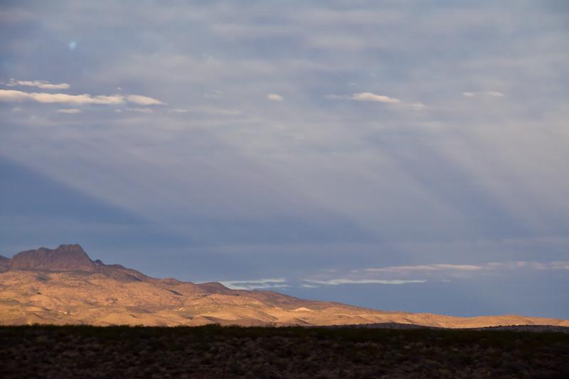 Early morning light on hills near El Paso, Texas. Sun rays light the hillsides.