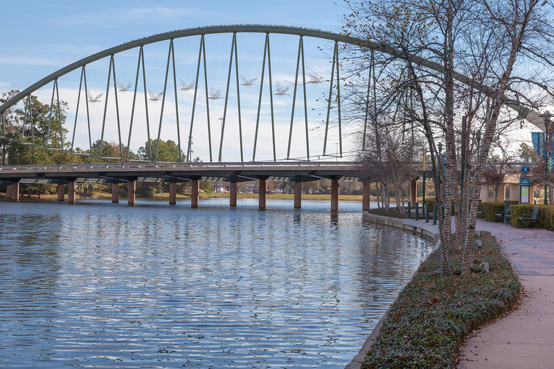 Bridge with Christmas doves, in December, over the Woodlands Waterway.