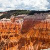 "Hoodoos and colorful cliffs at Cedar Breaks National Monument in Utah.  The Indians called Cedar Breaks the ""Circle of Painted Cliffs."" At an elevation of 10,000 feet, Cedar Breaks is shaped like a giant coliseum dropping 2,000 feet to its floor. Carved by millions of years of erosion, Cedar Breaks displays a huge amphitheater with stone spires, columns, arches, pinnacles, and colorful canyons."