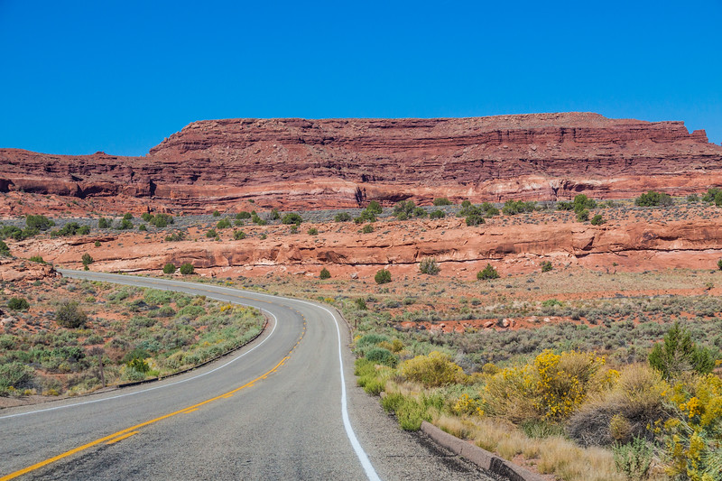 US 211 scenic byway in Utah, designated as Indian Creek Corridor Scenic Byway, passes through a dramatic landscape of sandstone rocks and formations on the way to Canyonlands National Park.