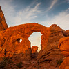 Turret Arch at sunrise in Arches National Park in Utah.