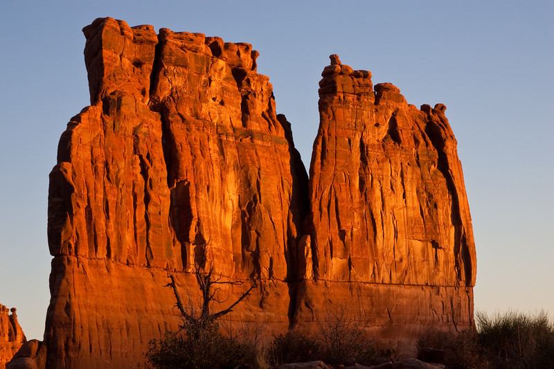 """Sunrise at The Organ Rock Formation in Arches National Park in Utah. Arches National Park contains the world's largest concentration of natural stone arches. This National Park is a red, arid desert, punctuated with oddly eroded sandstone forms such as fins, pinnacles, spires, balanced rocks, and arches. The 73,000-acre region has over 2,000 of these """"miracles of nature."""""""