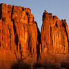 "Sunrise at The Organ Rock Formation in Arches National Park in Utah. Arches National Park contains the world's largest concentration of natural stone arches. This National Park is a red, arid desert, punctuated with oddly eroded sandstone forms such as fins, pinnacles, spires, balanced rocks, and arches. The 73,000-acre region has over 2,000 of these ""miracles of nature."""
