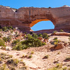 Located 24 miles south of Moab on US 191, Wilson Arch is a dramatic natural sandstone arch (called Entrada Sandstone).