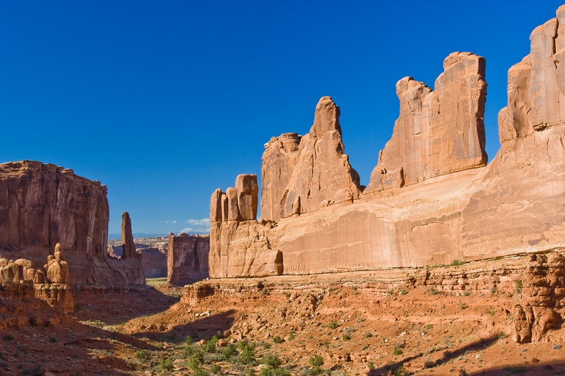 """Park Avenue Formations in Arches National Park in Utah. Arches National Park contains the world's largest concentration of natural stone arches. This National Park is a red, arid desert, punctuated with oddly eroded sandstone forms such as fins, pinnacles, spires, balanced rocks, and arches. The 73,000-acre region has over 2,000 of these """"miracles of nature."""""""