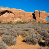 "The North Window Arch in Arches National Park in Utah. Arches National Park contains the world's largest concentration of natural stone arches. This National Park is a red, arid desert, punctuated with oddly eroded sandstone forms such as fins, pinnacles, spires, balanced rocks, and arches. The 73,000-acre region has over 2,000 of these ""miracles of nature."""