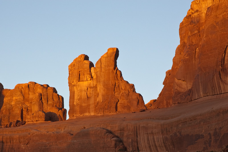 """Sunrise at Park Avenue Formations in Arches National Park in Utah. Arches National Park contains the world's largest concentration of natural stone arches. This National Park is a red, arid desert, punctuated with oddly eroded sandstone forms such as fins, pinnacles, spires, balanced rocks, and arches. The 73,000-acre region has over 2,000 of these """"miracles of nature."""""""