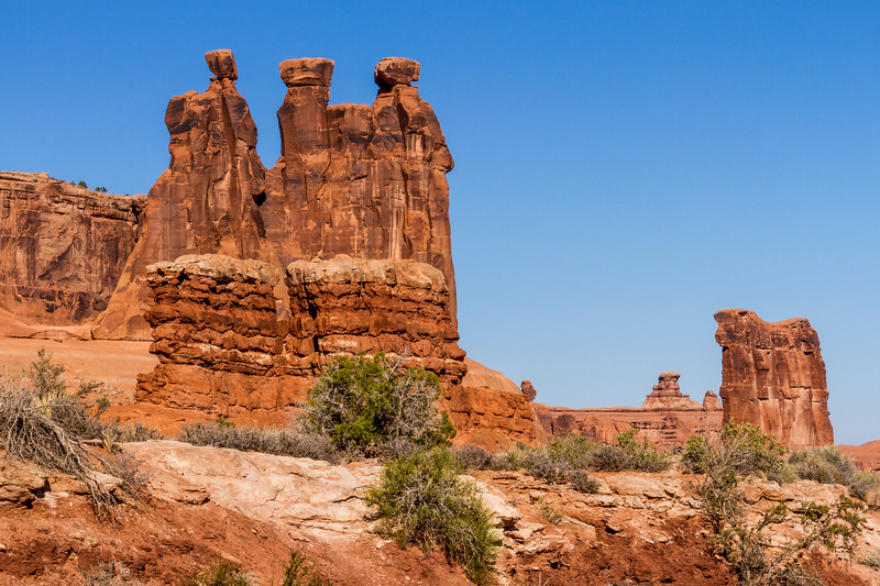 Three Gossips rock formation in early morning light at Arches National Park in Utah.