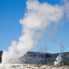 Old Faithful and Grand Geysers erupting in Yellowstone National Park in Wyoming.