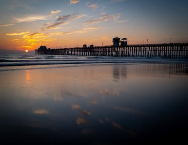 Reflection of sunset on the Oceanside Pier