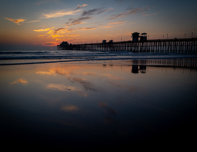 Reflection of the sunset at the Oceanside Pier