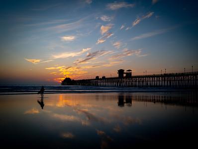 Surfer at the Oceanside Pier at Sunset