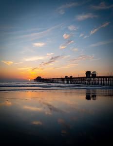 Reflection of the sunset at Oceanside Pier