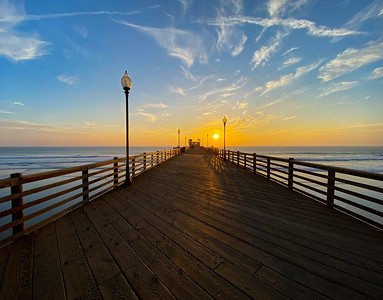Wooden deck of the Oceanside Pier at sunset