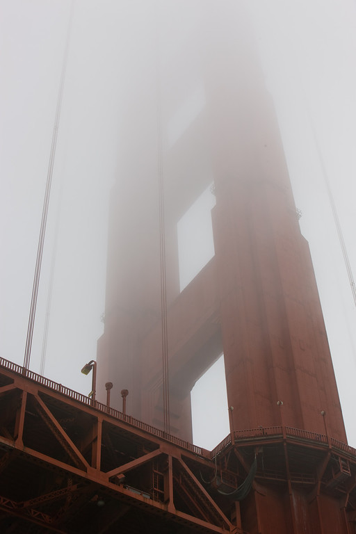 Pylon of Golden Gate bridge fading in fog