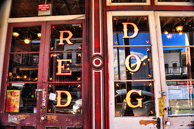January, 2013  The front doors and reflections of the Red Dog Saloon in Virginia City, Nevada.  I particularly liked this photo for the age and weathering on the wood of the doors, and of course, for the reflections too.  Check out the reflection in the upper right panes of the balcony of the old building across the street.