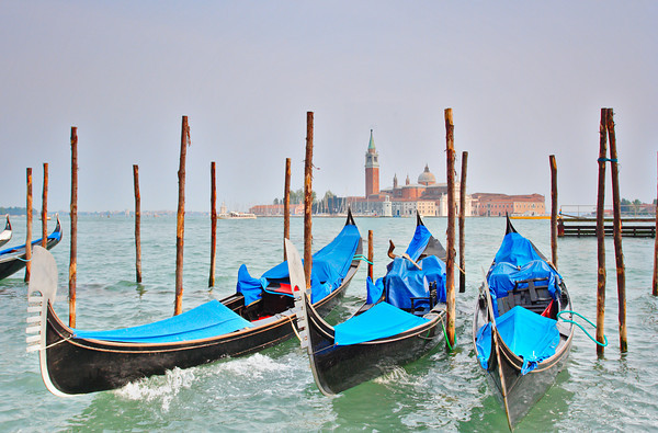 Gondolas moored at Molo San Marco in Venice Italy with San Giorgio Maggiore basilica in the background