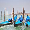 Gondolas moored at Molo San Marco in Venice Italy with San Giorgio Maggiore basilica in the background