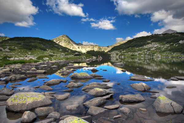 Glacial lake Zabecko with Hvoinat peak at national park Pirin, Bulgaria