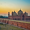 Pray and Play -- games of Cricket being played  outside wall of the historic Badshahi Mosque in Lahore, Pakistan