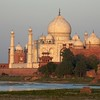The Taj Mahal turns orange during the sunset.