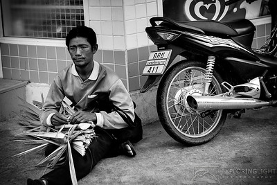 """STREETS OF KOH SAMUI""Koh Samui, ThailandMan outside a small shop on the streets of Koh Samui.© Chris Moore - Exploring Light PhotographyPURCHASE A PRINT"