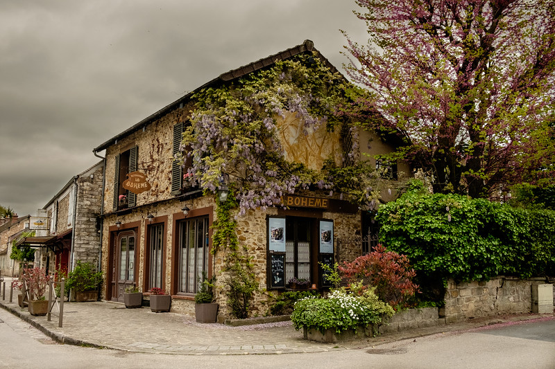 After Hours in Barbizon taken handheld on May 8th 2017 in the village of Barbizon, France using the Fuji X-T10 and the Fuji 18–55mm lens at 23mm, 1/250s, f/6.4, and ISO 2500. Editing was performed in Lightroom for color balance and to bring some detail back to the sky.