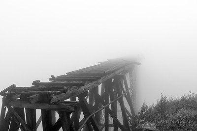 """INTO THE FOGGY MIST""White Pass SummitThe remnants of a century old railway used for gold mining disappears into the foggy mist.© Chris Moore - Exploring Light PhotographyPURCHASE A PRINT"