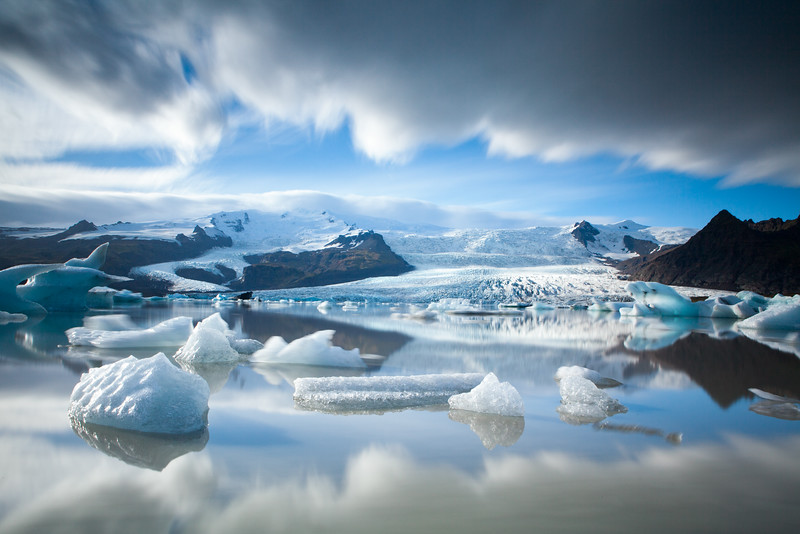Magical glacial ice in Fjallsárlón Glacier lagoon in front of the  volcano Öræfajökull