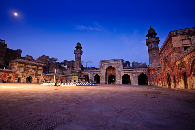 "A view of the historic Wazir Khan Mosque near Lahore's Delhi gate under moonlight.<br /> <br /> Masjid (Mosque) Wazir Khan's construction started around 1634 A.D. during the reign of Mughal Emperor Shahjehan and was completed in about 7 years. While much smaller than the famous ""Badshahi Mosque"" of Lahore and ""Jamma Masjid"" of Delhi, it is regarded as one of the most beautiful. The entire mosque is built with ""kankar lime"" with a sparkling of red sand-stone. Minarets are decorated with Mosaic Tiles fresco, kashi kari, geometric patterns and arabic / persian calligrahy in vivid colors.<br /> <br /> Geotag: <a href=""http://maps.google.com/maps?q=31.58327667"">http://maps.google.com/maps?q=31.58327667</a>,74.32371333&spn=0.001,0.001&t=k&hl=en"