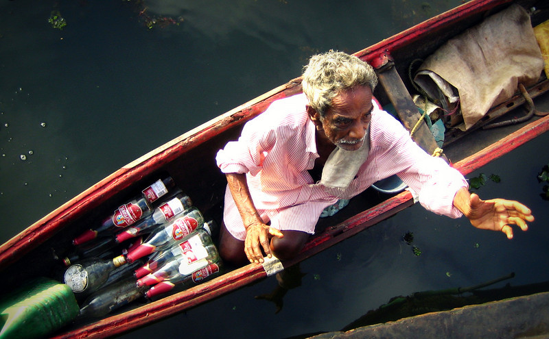 Collecting Kingfisher Empties - Kerala