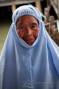"""MUSLIM LADY, PHUKET""Phuket, ThailandA senior Muslim lady in a small fishing village deep in the heart of Phuket.© Chris Moore - Exploring Light PhotographyPURCHASE A PRINT"