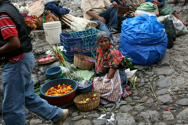 one of many vendors on the steps of the church in Chichicastenango