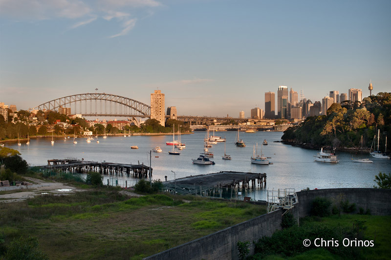 Sydney | Australia Old rotten wharfs leading the sight to the modern CBD