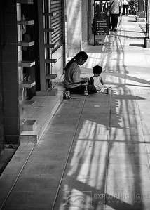 """STREETS OF BANGKOK""Bangkok, ThailandMother and child on the streets of Thailand.© Chris Moore - Exploring Light PhotographyPURCHASE A PRINT"
